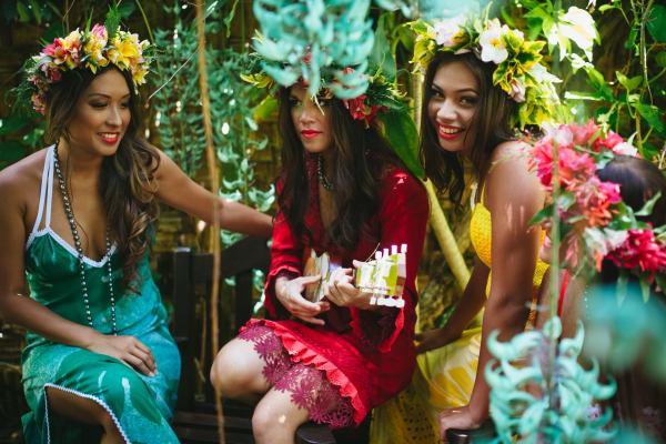 3 models pose in tropical garden