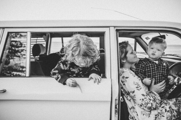 Family in vintage car