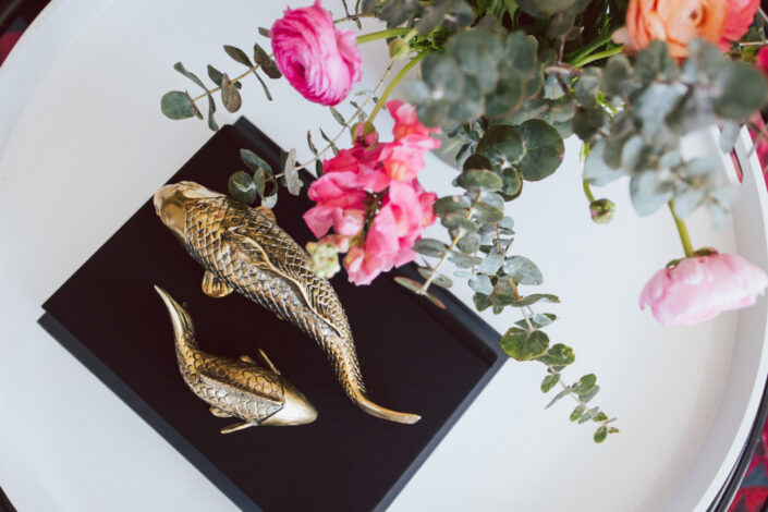 Brass koi and flowers