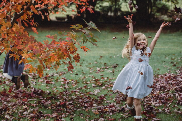 Child and autumn leaves