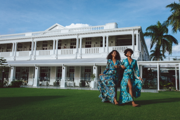Models walk on lawn in Fiji