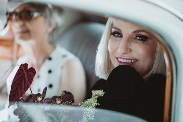 Bride to be in car